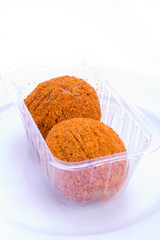 A pair of scotch eggs in supermarket packaging