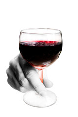 A hand holding a glass of red wine on white