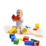 Baby playing with bright blocks