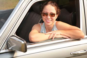 Woman smile through opened car window