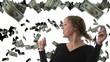 Beautiful woman catching falling dollars