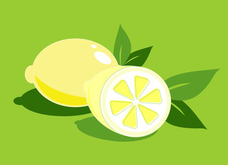 Two lemons on the green background