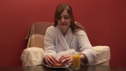 Young woman enjoying her breakfast