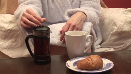 Close-up of a woman having her breakfast  with coffee
