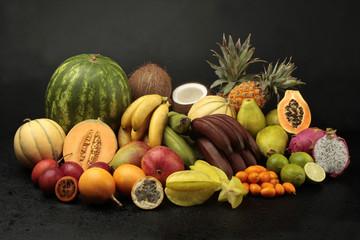 Exotic fruit arrangement on black background