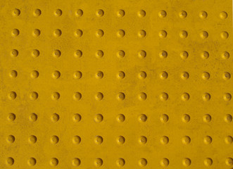 Grunge Yellow Texture of a Non-slip Pattern on a Sidewalk