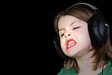 Young Child Singing with Headphones
