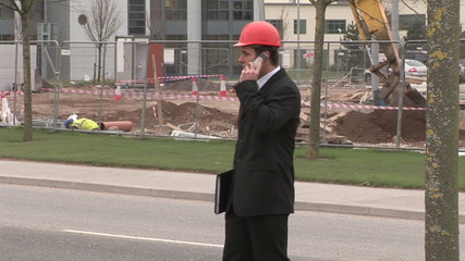 Well-dressed businessman at construction site