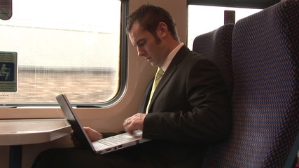 Handsome businessman working in a train
