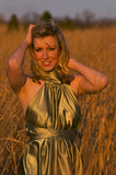 a model posing in a wheat field