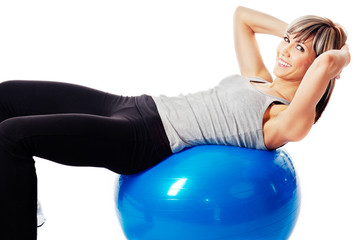 Sportswoman exercising on a Fitness Ball
