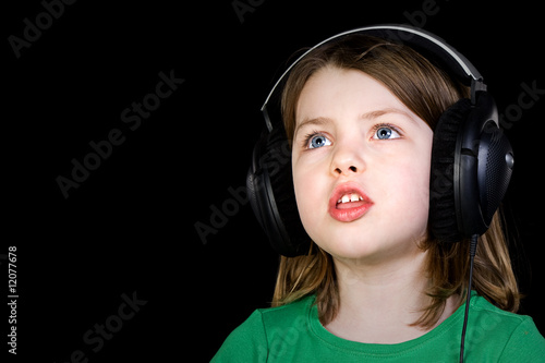 Cute Young Girl Singing with Headphones