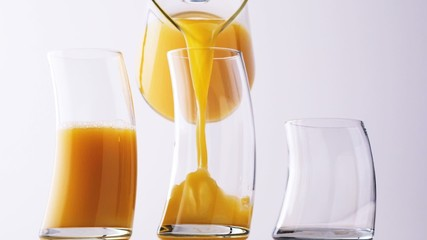 Pouring orange juice. ( Digital Cinema, HD, 1080p )