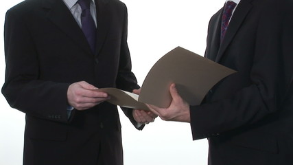 Two Businessmen Reviewing an important document