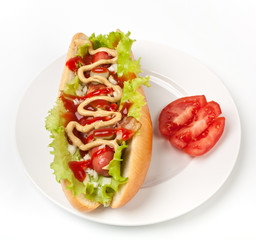 chicago hotdog with lettuce, pickles, onions and bacon