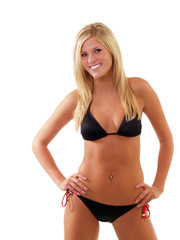 Smiling skinny young blond woman in black bikini