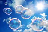 Soap bubbles on blue sky - 12097422