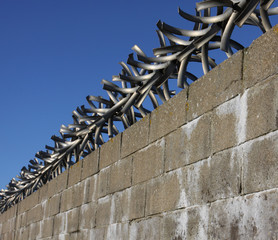 wall with metal spikes