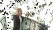 Beautiful blonde woman catching falling dollars