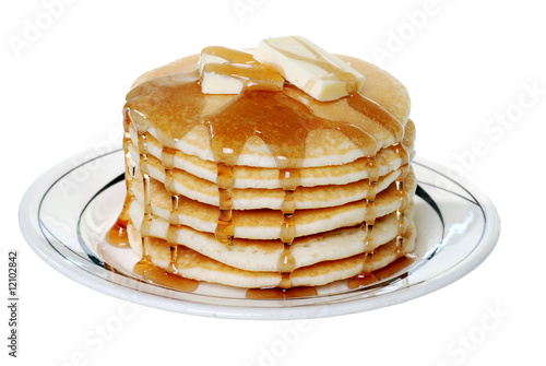 Isolated pancakes with butter and syrup - 12102842