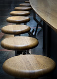 Bar stools in a row poster