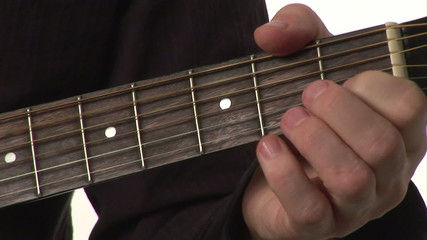 Closeup of a boy playing a classical guitar