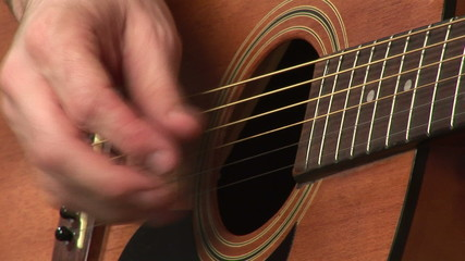 Closeup of a boy playing a Spanish guitar