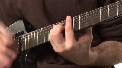Man's hands playing a guitar