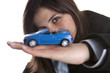 young businesswoman holding small car in the hand