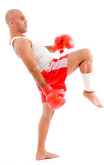 bald boxer in kicking pose