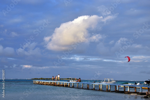 People strolling along blue jetty, Moorea French Polynesia
