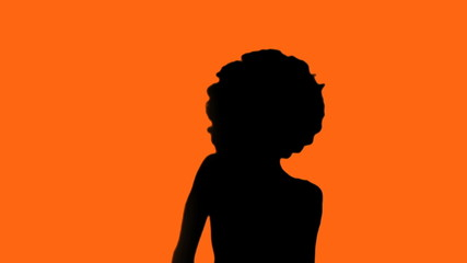 Afro chick against orange background martial arts - HD