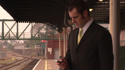 Businessman on phone in a train station footage