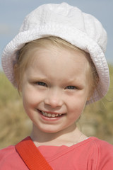 Portrait of cheerful girl on the beach