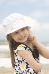 Cheerful girl in beautiful dress and hat III