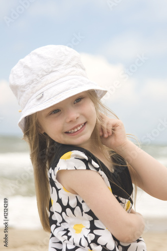 Cheerful girl in beautiful dress and hat III