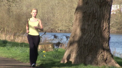 Woman running outdoors footage