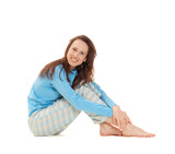 smiley woman in blue pajamas sitting on the floor poster