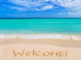Fototapety Word Welcome on beach