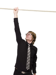 Man hanging in a rope with one hand