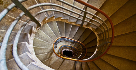 Old spiral staircase with marble steps