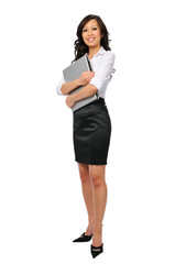 Young businesswoman with laptop standing