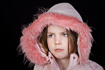 Cute Child in Pink Hood Looking Off Camera