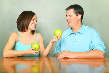 Kind Girlfriend Offering Green Apple To Young Male Caucasian