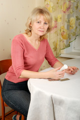 Adult woman with pills