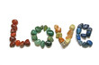 Love written in tumbled stones on white background
