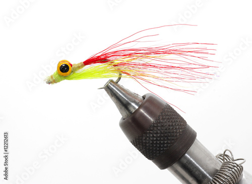 Fly fishing lure in holder