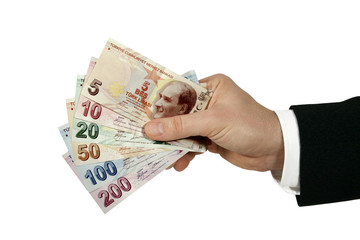 turkish lira in businessman's hand