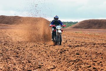 Offroad motorbike driving in dirt.