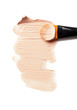 professional brush and foundation sample on white